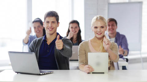 students in computer class showing thumbs up Stock Video Footage