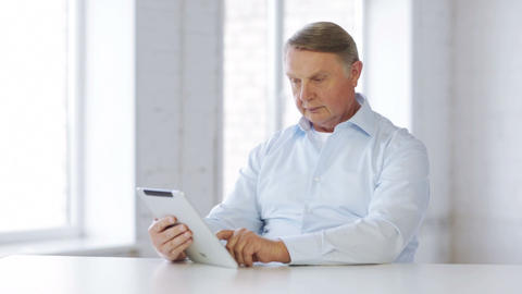 Old Man With Tablet Computer At Home stock footage