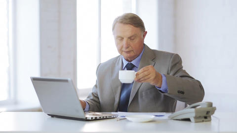old man with laptop computer drinking coffee Stock Video Footage