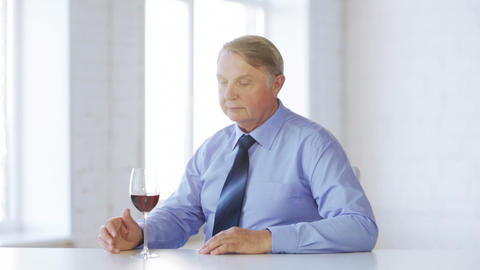 expert in suit and tie with a glass of red wine Stock Video Footage