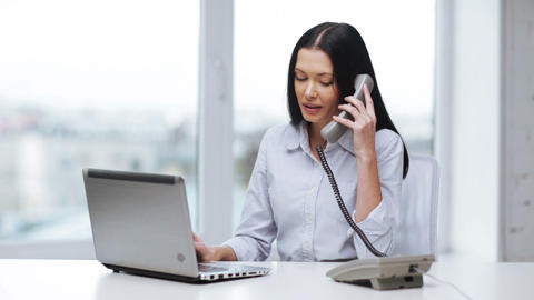 attractive office worker taking phone call Stock Video Footage