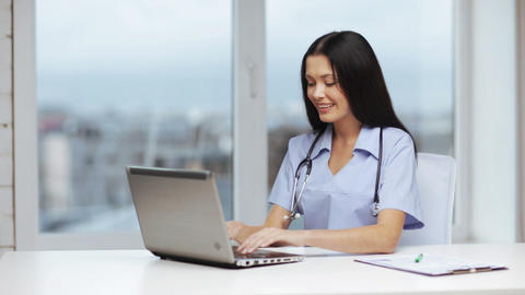 Doctor Or Nurse With Laptop Pc Writing Prescriptio stock footage