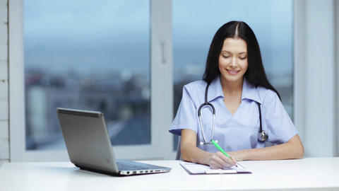 doctor or nurse with laptop pc writing prescriptio Stock Video Footage