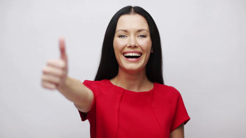 young woman with thumbs up Stock Video Footage
