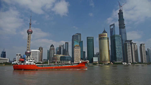 red ship sails through downtown Shanghai,Lujiazui... Stock Video Footage