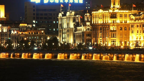 view Shanghai Bund from pudong at night,huangpu river & Tourists crowded Animation