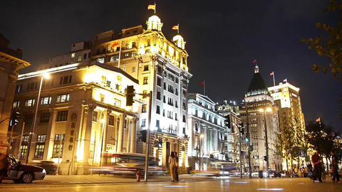 time lapse Shanghai bund traffic at night,Brightly lit old-fashioned building Animation