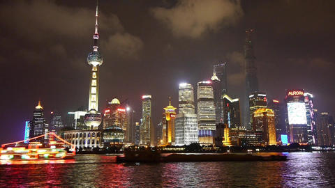 Brightly lit ship passing Shanghai huangpu river at... Stock Video Footage