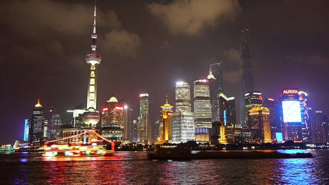 Brightly lit ship passing Shanghai huangpu river at night,Lujiazui business hub Animation