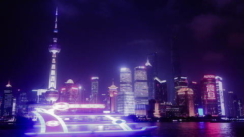 Brightly lit ship passing Shanghai bund at night,Lujiazui economic center Animation