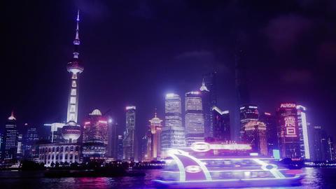 Brightly lit ship passing Shanghai bund at night,Lujiazui... Stock Video Footage