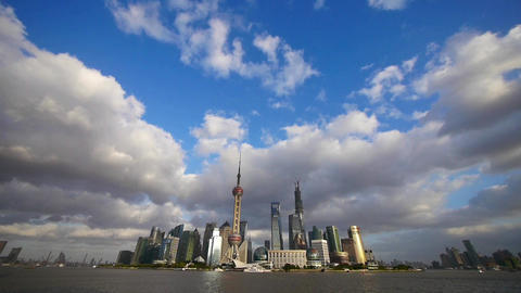 time lapse Shanghai skyline & flying cloud,world economic Centre & urban Animation