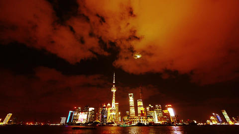 time lapse Shanghai at night,Brightly lit ship passing world financial hub Animation