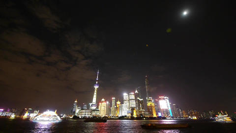 Shanghai bund at night,Brightly lit ship passing world... Stock Video Footage