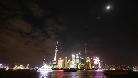 Shanghai bund at night,Brightly lit ship passing world... Stock Video Footage