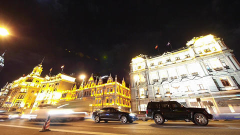 time lapse Shanghai bund traffic at night,old-fashioned business building Animation