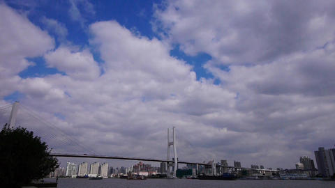 time lapse of flying cloud,shipping on river,across the sea bridge in shanghai Animation