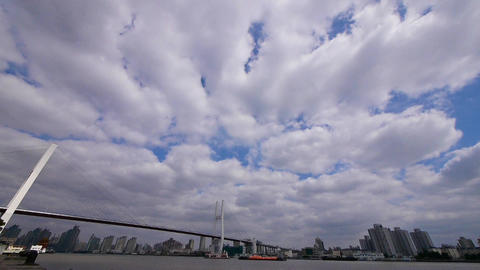 flying cloud,shipping on river,across the sea bridge in... Stock Video Footage