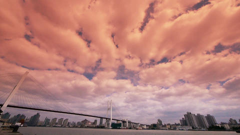 time lapse of flying sunset glow cloud,shipping on river,across the sea bridge Animation