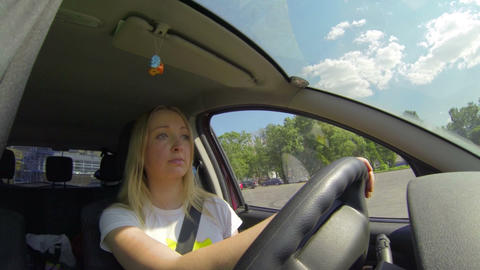 Blonde Behind The Wheel Of The Machine stock footage