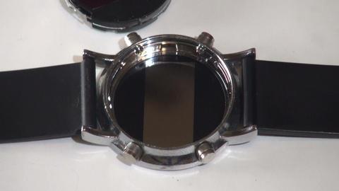 Repair manual electronic clock Stock Video Footage