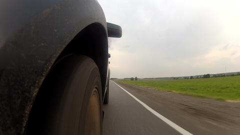 Travel on highway along the field Footage