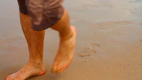 People walking on the sand Stock Video Footage