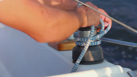 Sailor ties rope on handling appliance Stock Video Footage