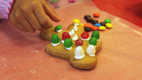 Adding Candy To Christmas Gingerbread Man Cookie Stock Video Footage