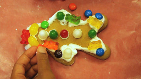 Christmas Gingerbread Man Cookie Gets More Candy Stock Video Footage