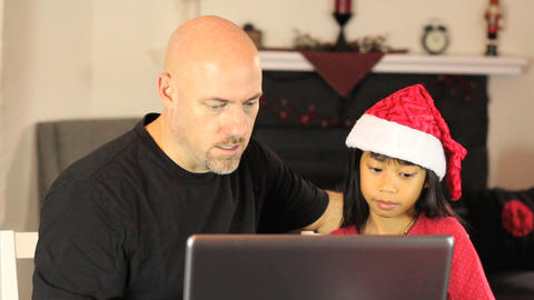 Dad And Daughter Shop Online For Christmas Gifts Stock Video Footage