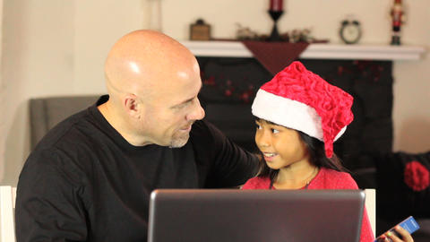 Dad And Daughter Shop Online For Christmas Gifts Footage