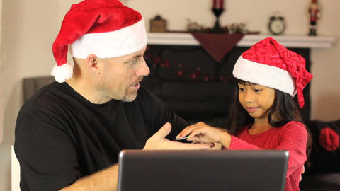 Excited Online Christmas Shoppers Using Laptop Footage