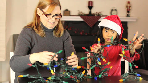 Girls Untangling Christmas Lights Footage