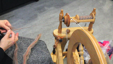 Lady Spinning New Yarn Stock Video Footage