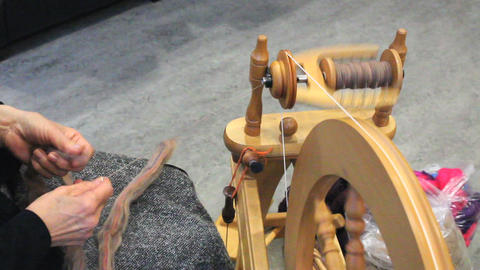 Lady Spinning New Yarn stock footage