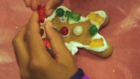 Gummy Bears On Christmas Gingerbread Man Cookie Stock Video Footage