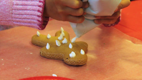 More Icing On Christmas Gingerbread Man Cookie Stock Video Footage