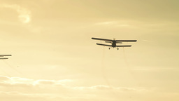 Planes spraying for mosquitoes Stock Video Footage