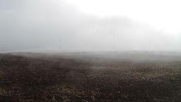 Fog crawling over cultivated soil Stock Video Footage
