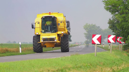 Agricultural Vehicle Passing In Rural Area stock footage