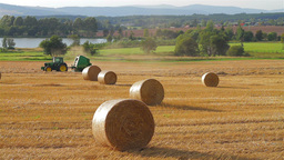 Tractor forming a hay bale Stock Video Footage