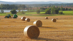 Tractor forming a hay bale Footage