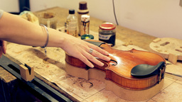 Music Repair Lab Girl Caressing Violin stock footage