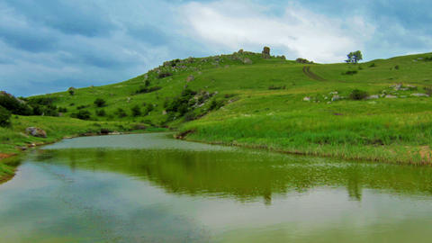 mountain river in the background of green hills Stock Video Footage