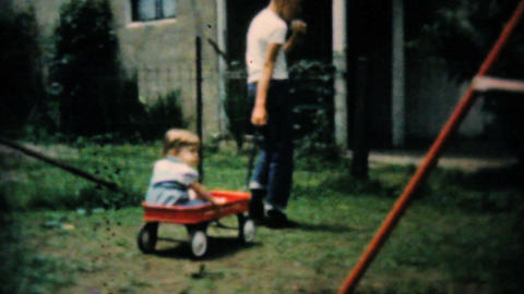 Baby Girl In Backyard Pulled In Red Wagon 1961 Stock Video Footage