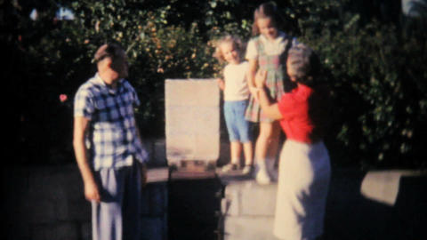 Grandparents With Grandkids On Outdoor Barbecue Stock Video Footage