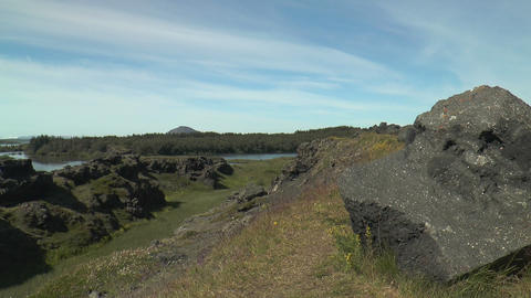 basalt rocks and lava stones at lake myvatn in ice Stock Video Footage