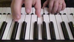 Playing piano keyboard 2 Stock Video Footage