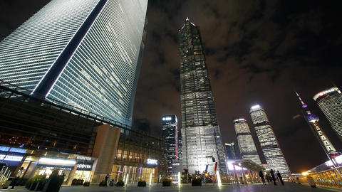 time lapse,busy pedestrian passing shanghai huanqiu skyscraper at night Animation